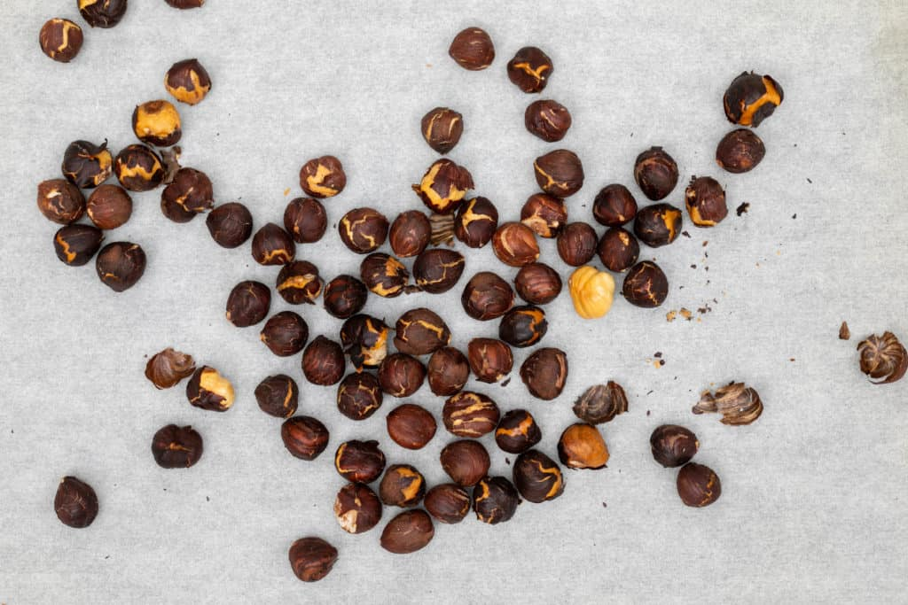 toasted hazelnuts on parchment paper
