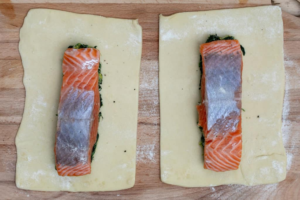 2 pieces of puff pastry with salmon and spinach mixture on top of each