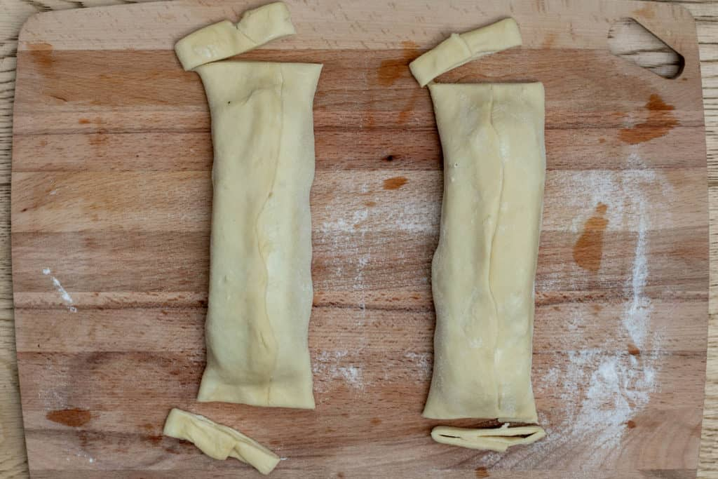 2 puff pastry salmon wellington packets with edges cut off