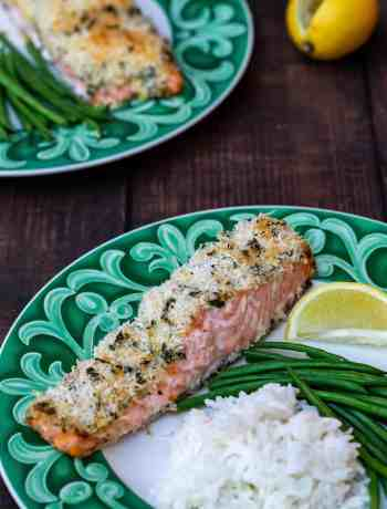 panko crusted salmon fillets with rice and green beans and lemon on green plates