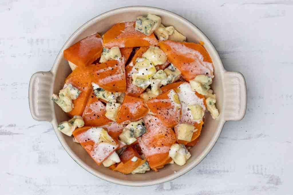 Sweet potato gratin in gratin dish ready for oven