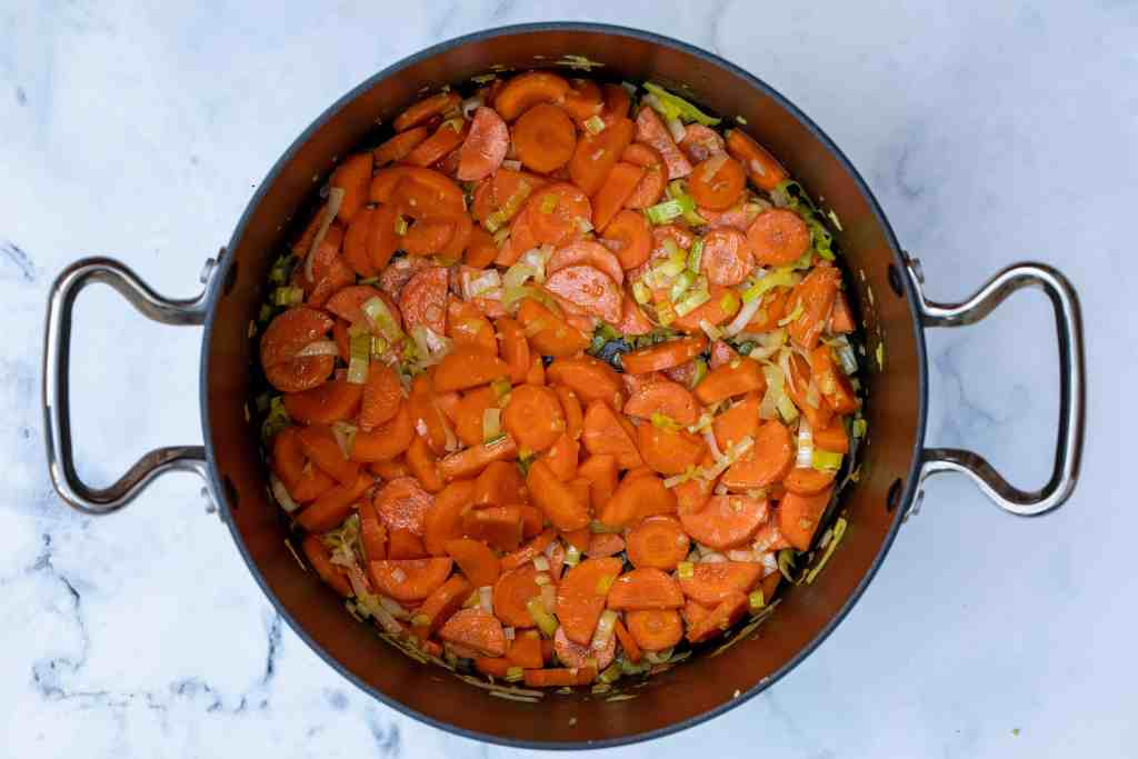 sautéed carrots, leeks, and ginger in butter and olive oil in large pot