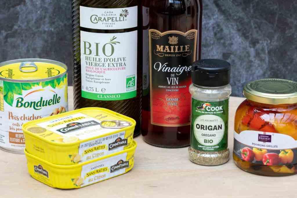 ingredients for sardines on toast: sardines, chickpeas, olive oil, red wine vinegar, oregano, roasted peppers