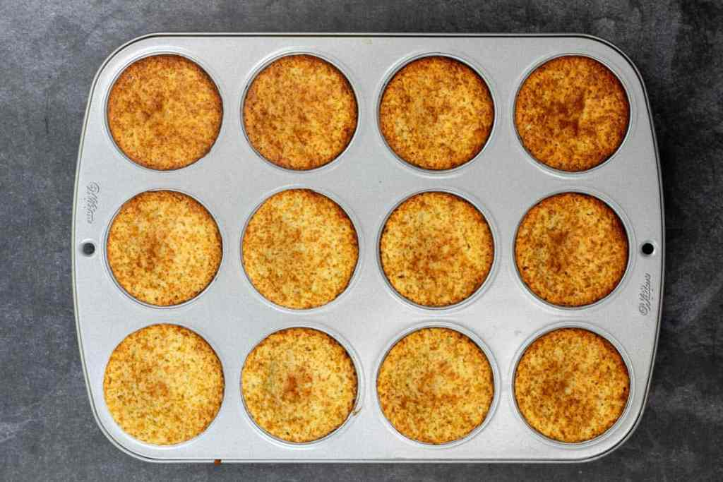 lemon almond flour muffins baked, in muffin tin