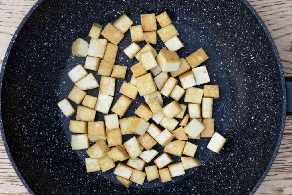 browned tofu in large wok