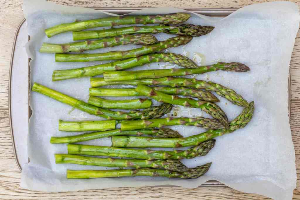 Asparagus on sheet pan ready to be roasted