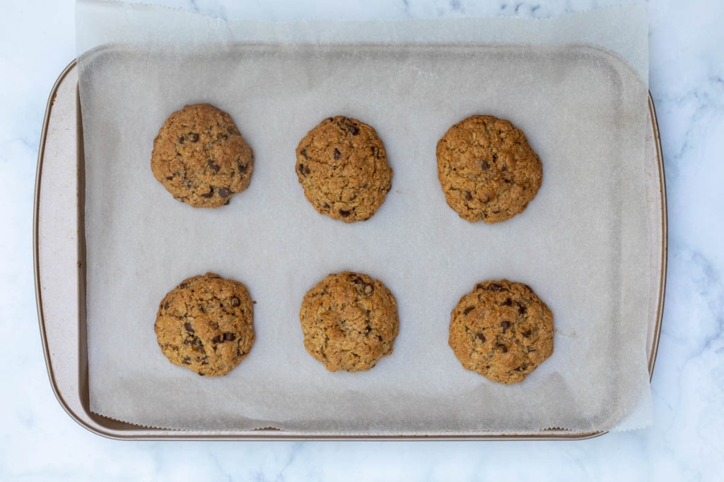 baked almond flour oatmeal cookies on parchment-lined sheet pan