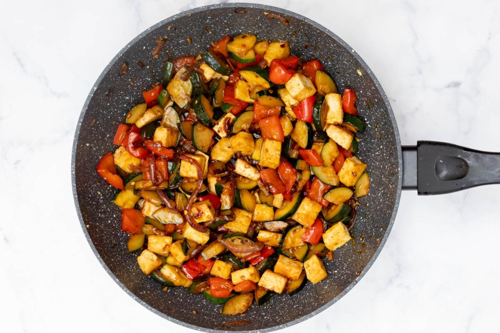 zucchini stir-fry with tofu and red bell pepper in large nonstick skillet