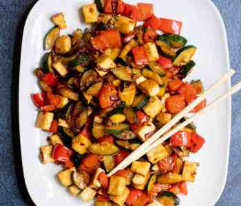 serving platter with zucchini stir-fry with chopsticks