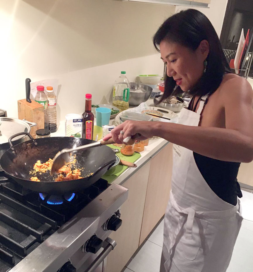 In the kitchen with Kell who expertly stir fries the Crab with Curry Powder.