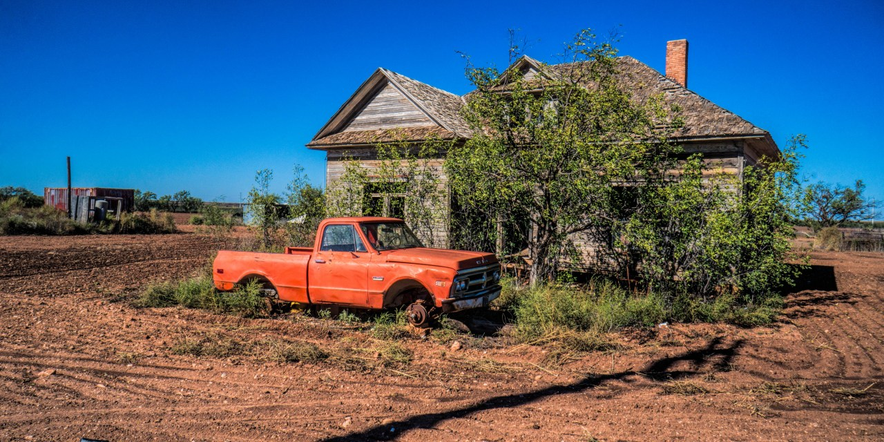 Abandoned Farm House and GMC Truck sitting on Blocks in Anson, Texas