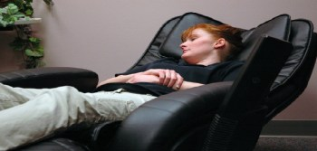Woman relaxing on a recliner chair