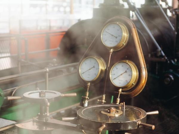 A pressure gauge with steam rising up in front of it