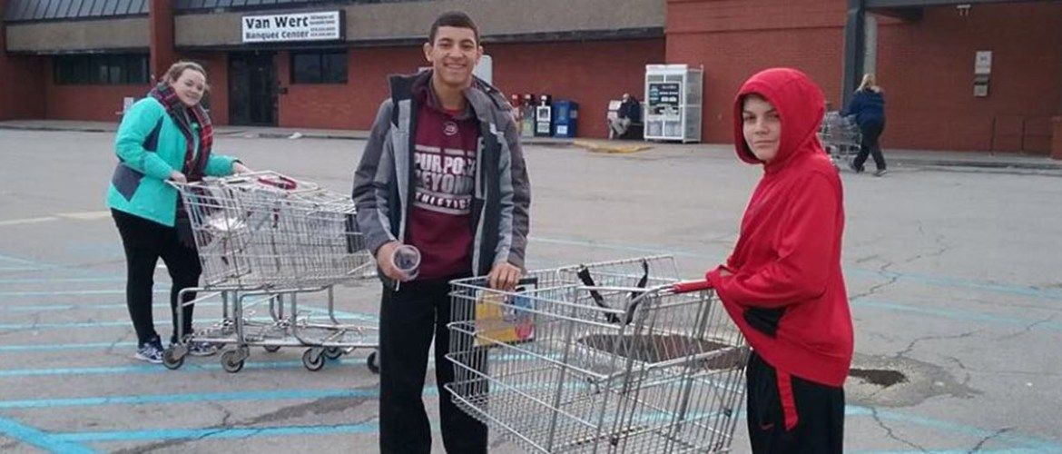Youth returning carts at local grocery
