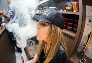 Girl Vaping Clouds