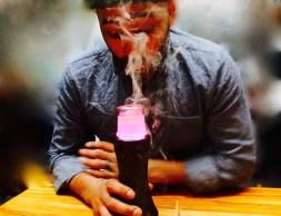 A man using Dr.Dabber vaporizer