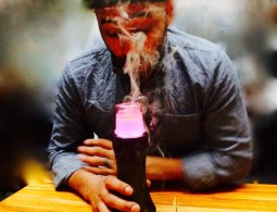A man using Dr.Dabber vaporizer