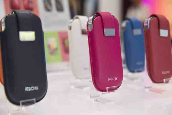 IQOS devices on display in colorful cases