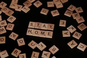 Scrabble pieces reading 'Stay Home'