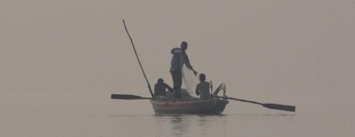 0204-Man pulling nets on fishing boat on Ganges Varanasi Benares Oct 30, 2010 6-54 AM 3369x2699