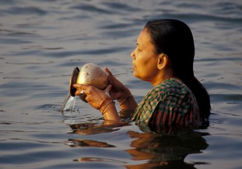 0351-Woman in Ganges doing prayer spilling water Sep 1, 2012 2-18 PM 4745x3312