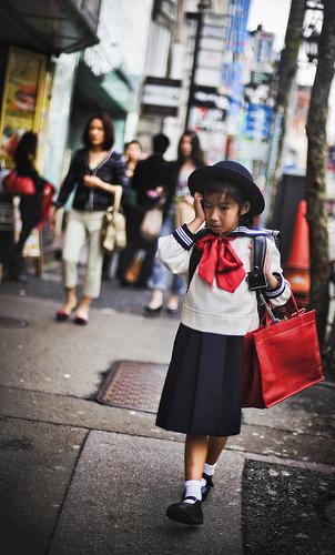 Young Schoolgirl Returning Home in Tokyo