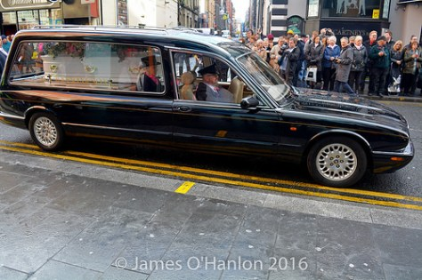 The hearse carrying Herberts Coffin arrives