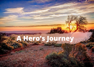 Text reals A Hero's Journey in front desert sunset