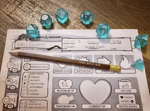 Dungeons and Dragons modified character sheet with set of blue polyhedral dice