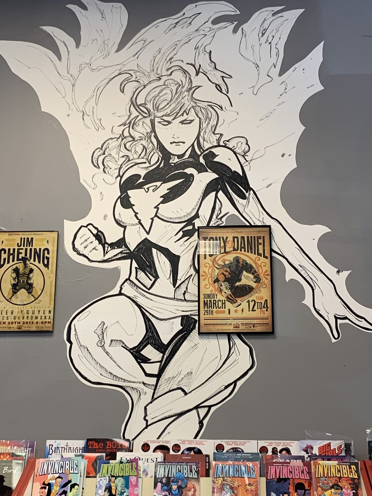 Superhero female form is painted on a wall