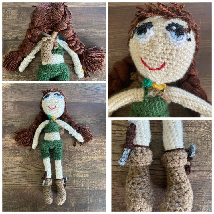 A crocheted humanoid form