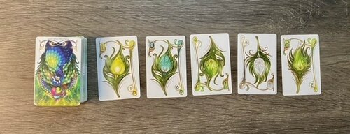Run of cards featuring peacock feathers