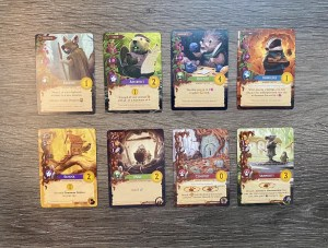 Eight Everdell cards, four critter and four location cards