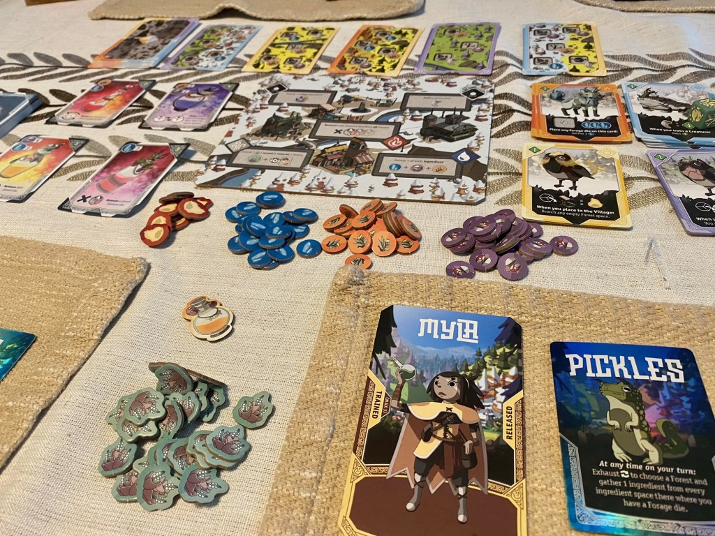 Brew game pieces and cards on table