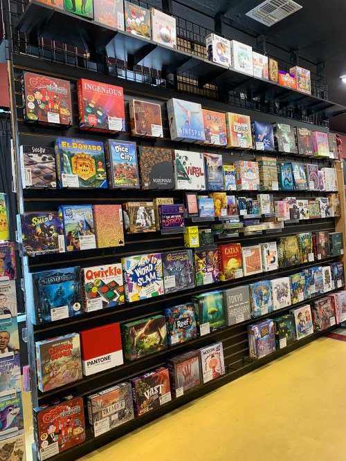 An array of board games for purchase at BAMF Comics. Several Board games are also available to rent for the day.