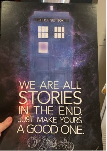 """Print of blue police call box with text reading """"We are all stories in the end. Just make yours a good one."""""""