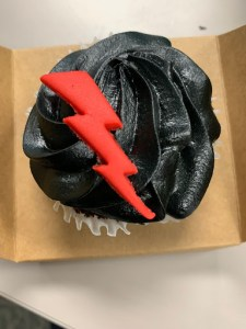 Cupcake with black frosting and red lightning bolt