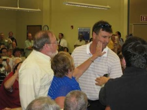 Tampa Obama plan supporter assults protester who did not fight back