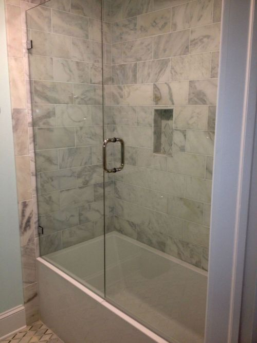 ALTHOUGH MOST BATHTUB ENCLOSURES ARE SLIDING DOORS WITH METAL AROUND THE PERIMETER, WE INSTALLED A SWING F RAMELESS DOOR WITH STATIONARY PANEL TO KEEP THE CLEAN FRAMELESS LOOK.  JOB WAS LOCATED IN RICHMOND VA