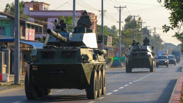 Soldiers in military armoured vehicles in Myitkhina, Myanmar