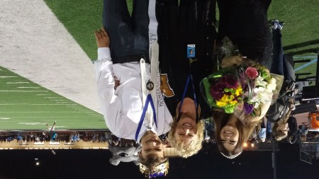 From left: Mia Mumford, Robin Fenstermacher and Ian McKeever celebrated Ian's nomination as homecoming king at a Buena High football game last week.