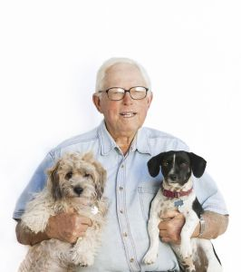 """Madeleine (Maddie) Wilson took this photo for her Lighting People class in a project called """"Final Six"""". It is a photo of her grandfather Wes Wilson and his two dogs, Danny and James."""