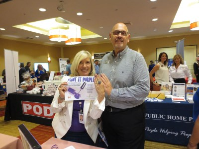 Catherine Kort, Interface and Ventura County Coastal Association of Realtors, President Elect Lyle Elliott paint their nails purple at VCCAR's recent annual trade show at the Oxnard Marriott.