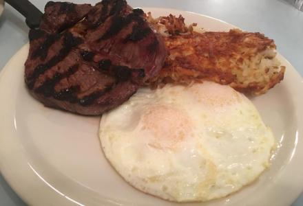 Steak and eggs with hash browns.