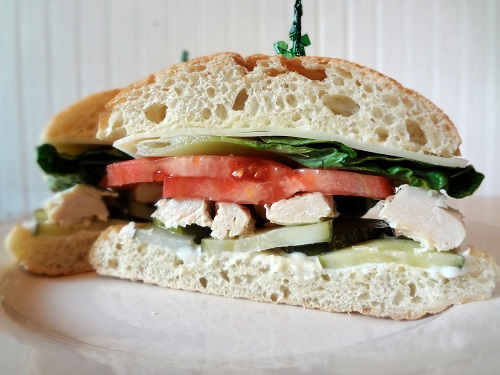 cold-sliced chicken breast, lettuce, tomato, and mayonaise on ciabatta roll