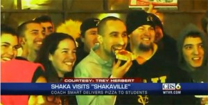 """CBS cameras filmed Shaka Smart hanging out and eating pizza with students who braved the cold weather to participate in last season's """"Shakaville""""."""