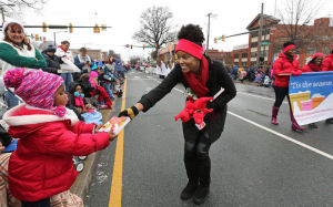 Richmond's official Christmas Mother, Maya Smart, spreading some cheer at this year's Christmas parade. (photo by the Richmond Time's Dispatch's P. Kevin Morley)