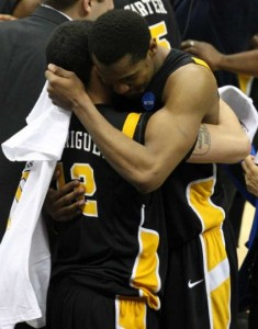 Burgess and Rodriguez congratulate each other after defeating Kansas in the 2011 Elite 8.