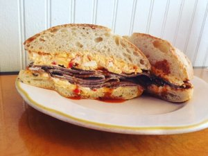 """Garnett's latest creation """"The Coach"""" is a Will Wade-inspired roast beef sandwich with tiger sauce and pimento cheese."""