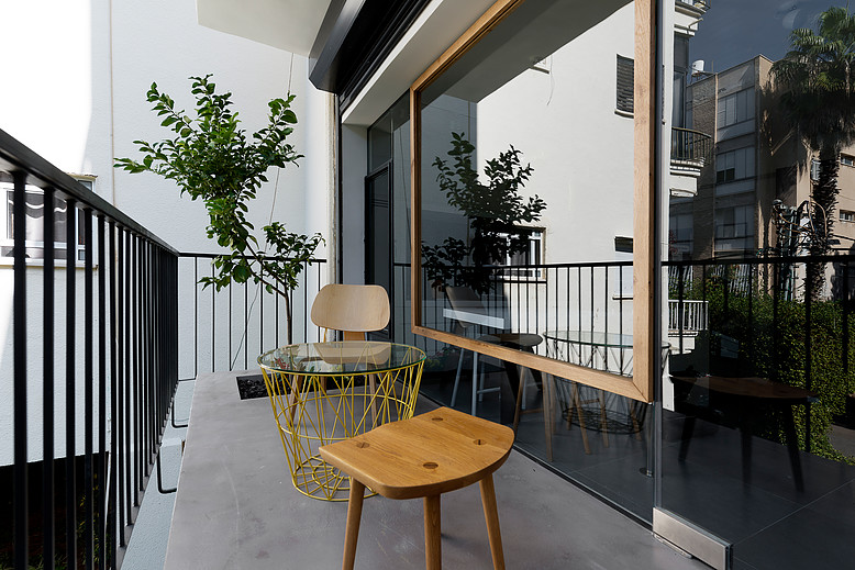 balcony with a planted lemon tree